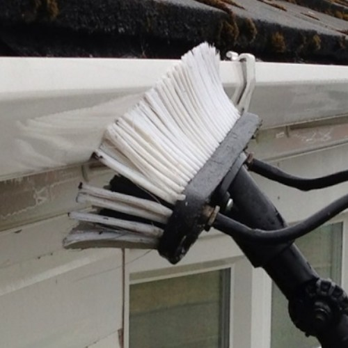 cleaning house fascias and soffets with a brush