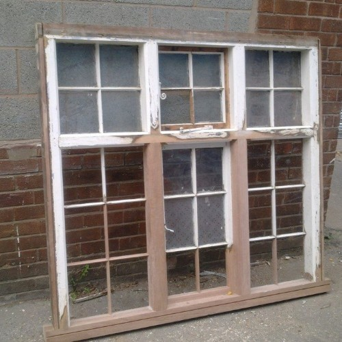 A window frame removed from a house that has been prepared for painting