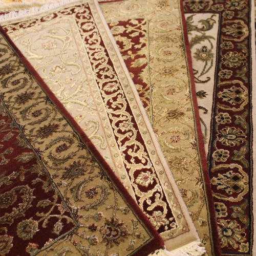 a set of persian rugs laid out on the floor